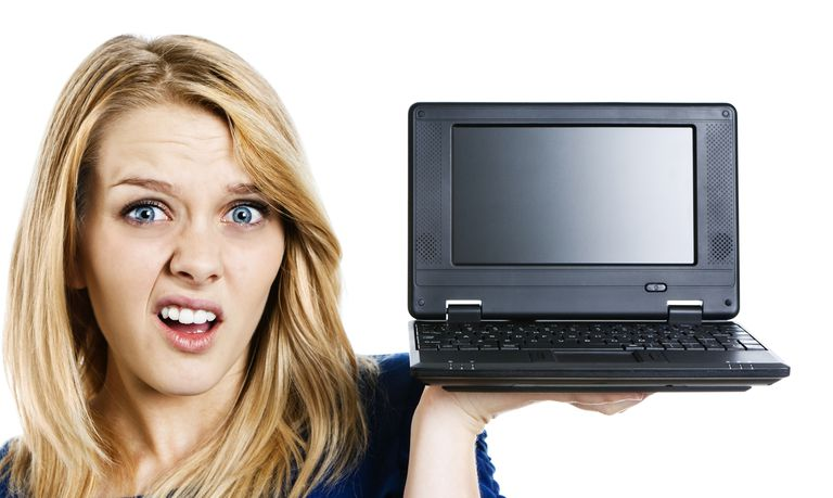 Cuter but confused blonde teenager with tiny computer