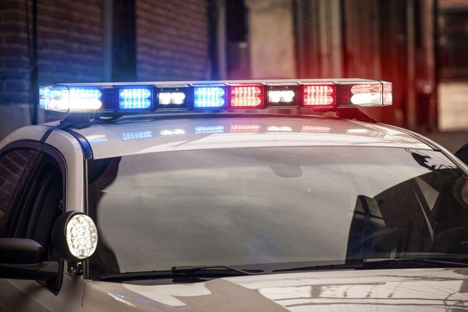 A police car with illuminated light bar