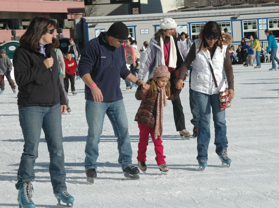 Skaters enjoying the ice rink in downtown Reno, Nevada.