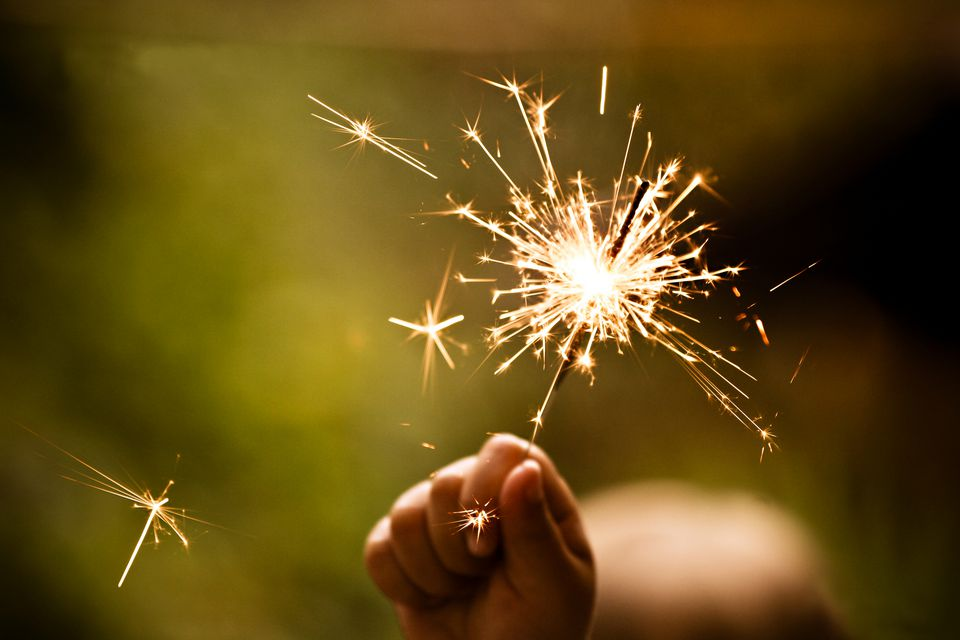 Child holding sparkler