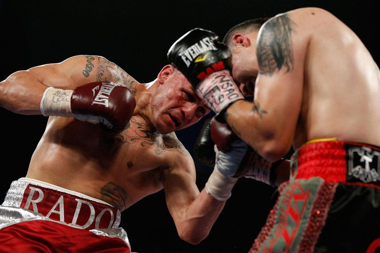 LAS VEGAS, NV - MARCH 30: (L-R) Mike Alvarado throws a left uppercut to the head of Brandon Rios in their WBO interim junior welterweight championship bout at the Mandalay Bay Events Center on March 30, 2013 in Las Vegas, Nevada.