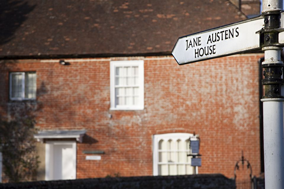 Signpost to Jane Austen's house in background, Chawton, Alton, Hampshire, England, UK