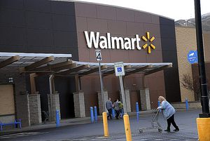 woman pushing cart into Walmart store