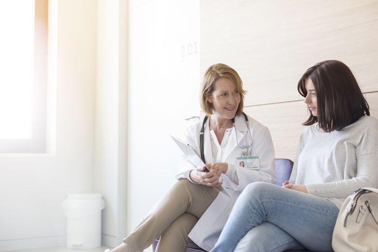 Psychiatrist talking to patient