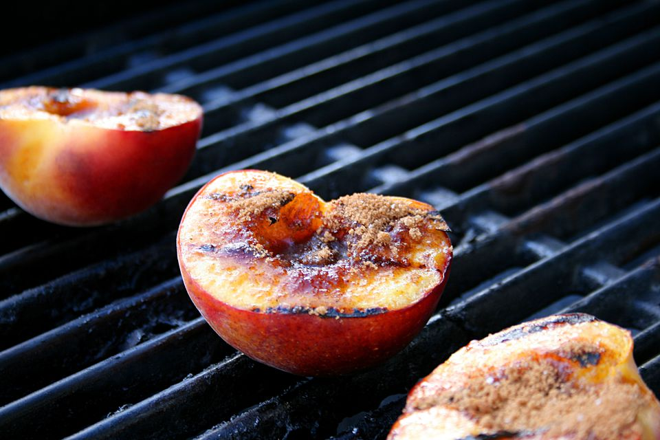 Grilling peaches on a grill