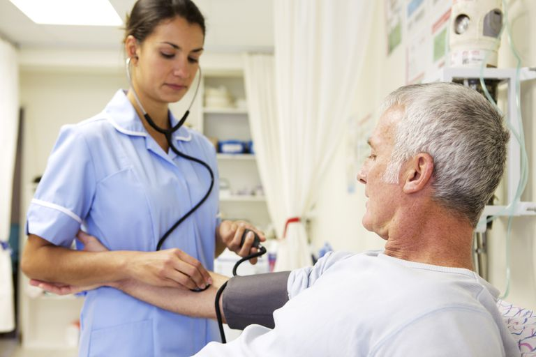 Nurse taking man's blood pressure at clinic