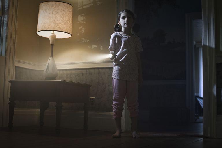 girl with flashlight