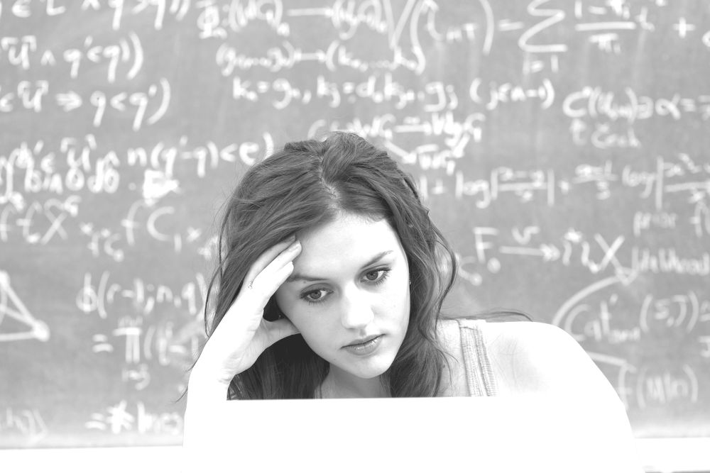 Image of a Young Woman Trying to Answer a Skill Testing Question