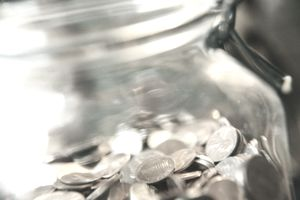 SPARE CHANGE IN JAR, CLOSE UP
