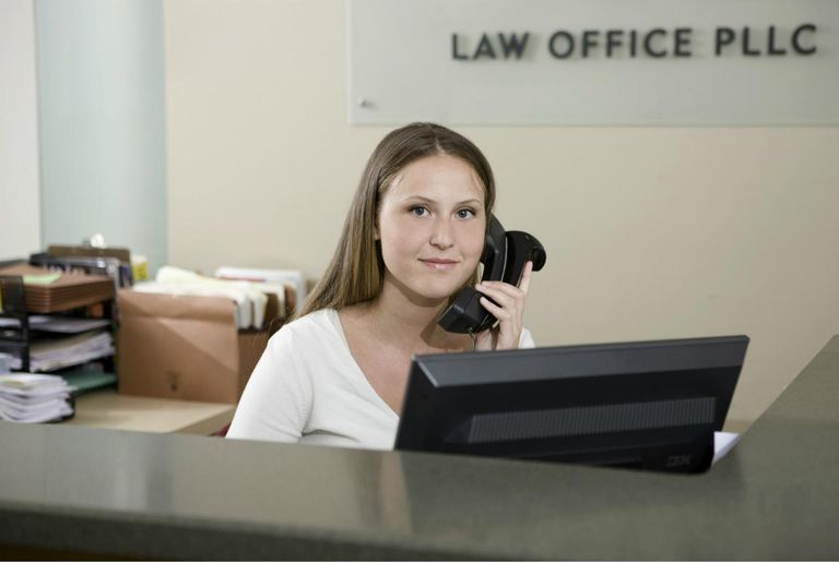 Receptionist answers a call