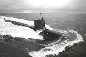 Submarine on a mission descending into the ocean.