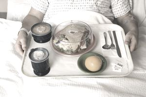 Patient with hospital food on a tray