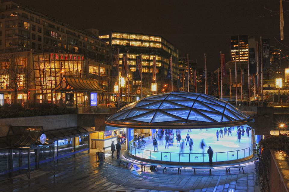 Robson Square ice rink, lit up at night.