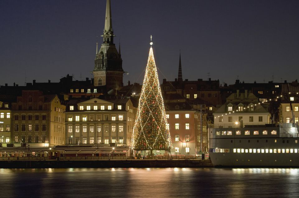 Sweden, Stockholm, Illuminated Christmas tree at harbour