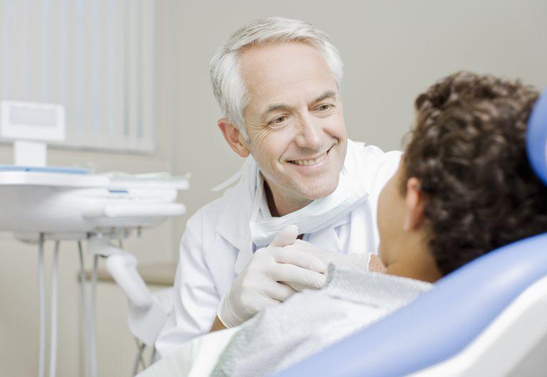 Dentist examining boys teeth