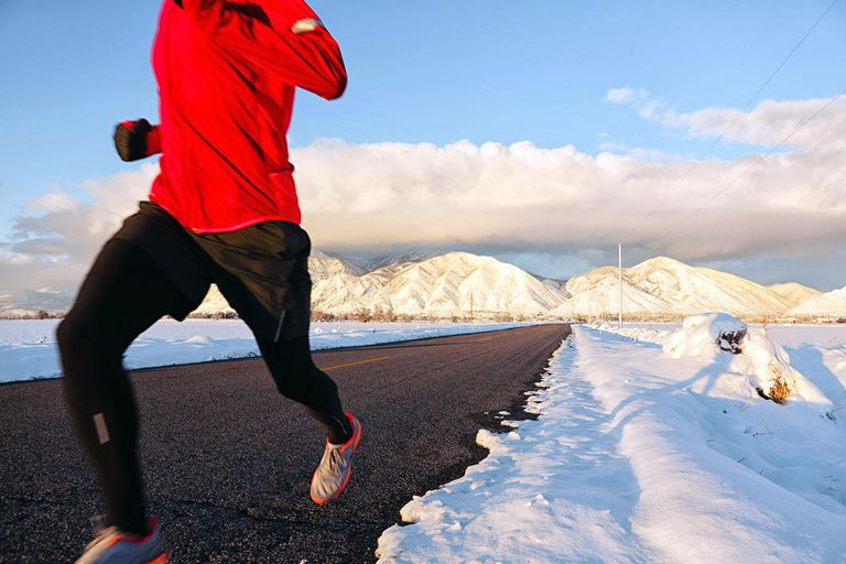 An unidentified male runner braves the elements on a cold winter afternoon in Utah.