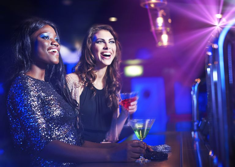 Woman with drinks at the club