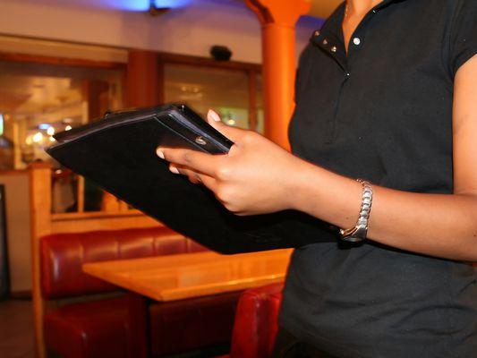 Restaurant owner holding a menu