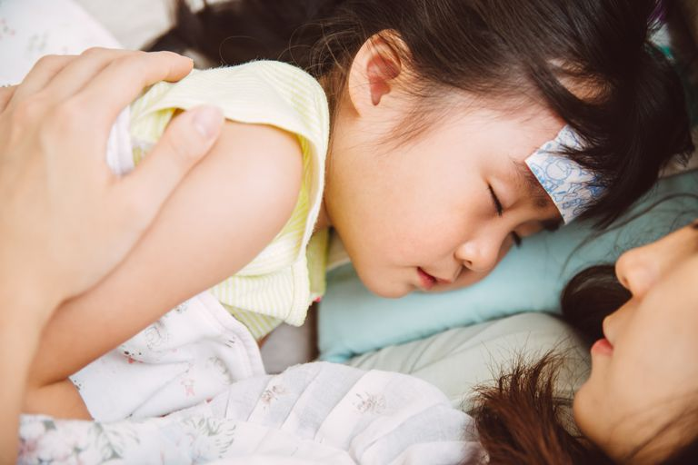 Sick child and mom cuddling