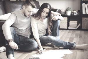 couple doing paperwork on the floor