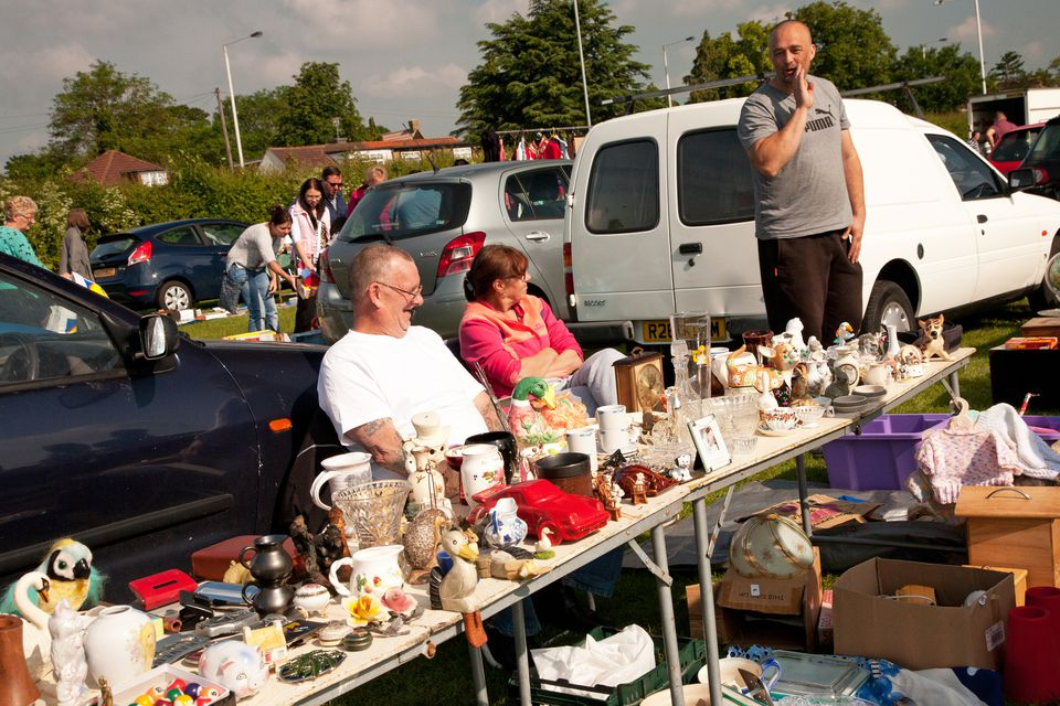 shoppers and sellers at highway yard sale