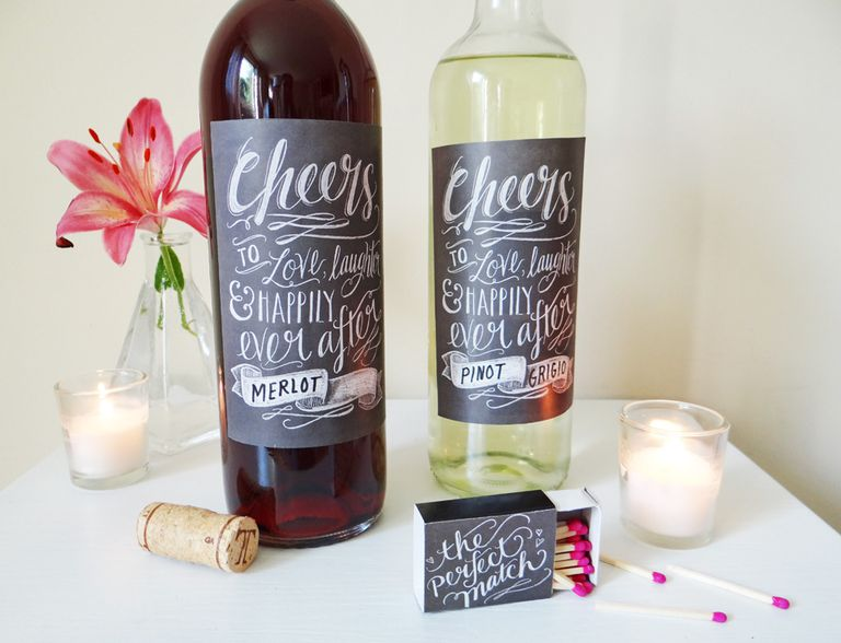 Two wine bottles with chalkboard style wedding labels