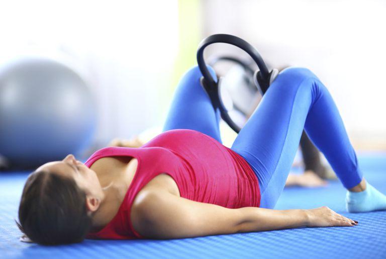 pregnant woman with Pilates magic circle