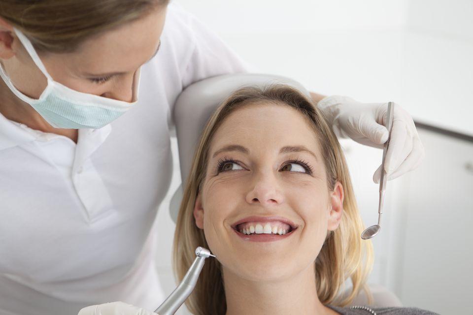 Women dentist and pretty patient