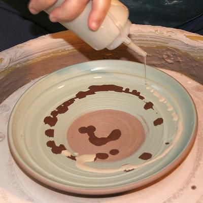 Slip trailing is a commonly used method of decorating pottery with slip.