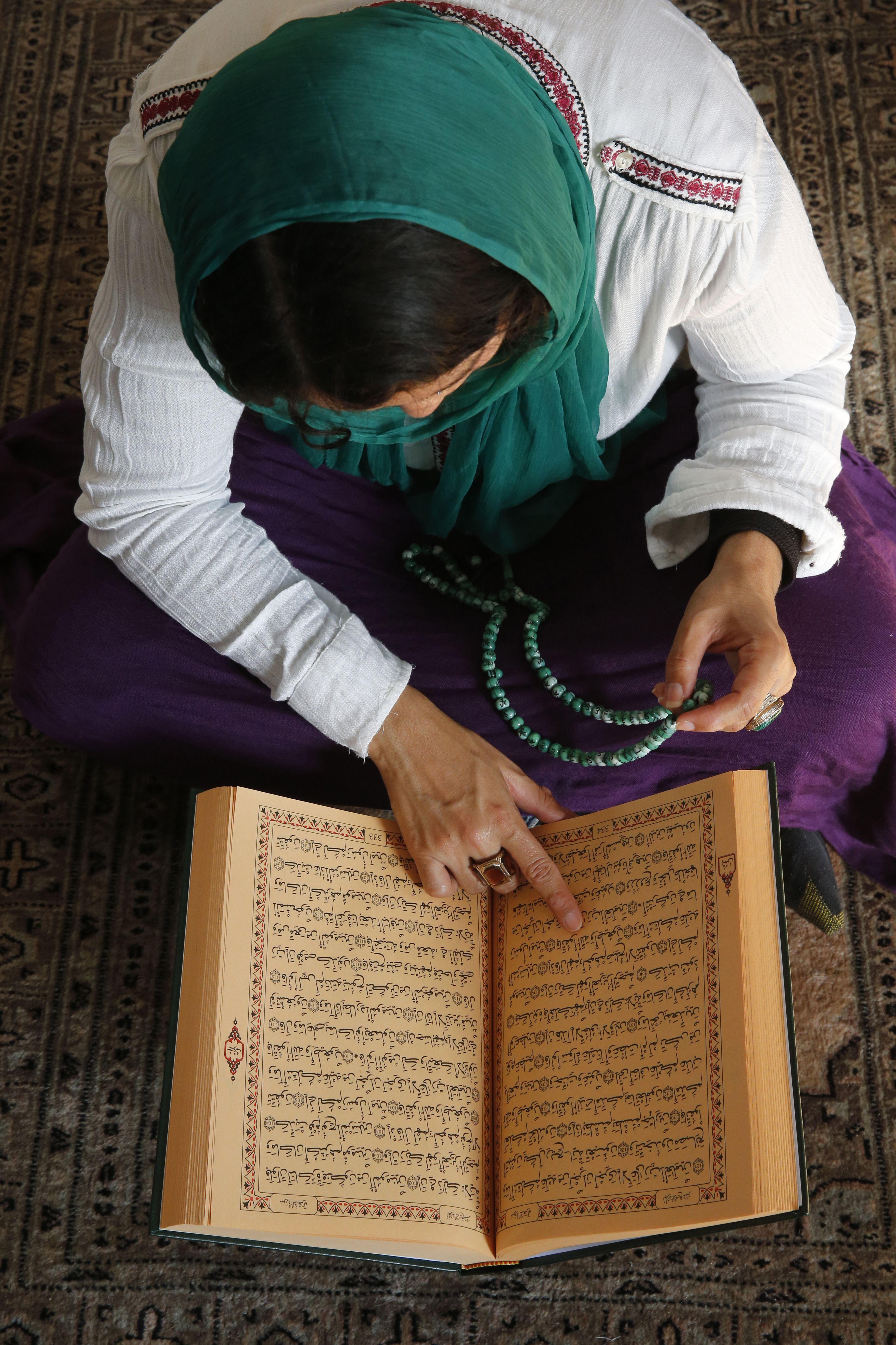 Muslim Woman Reading Quran