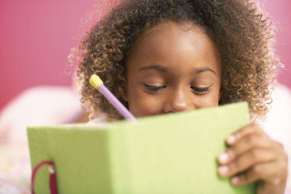 Young girl writing in diary