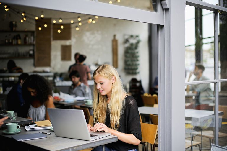 Woman on laptop in cafe