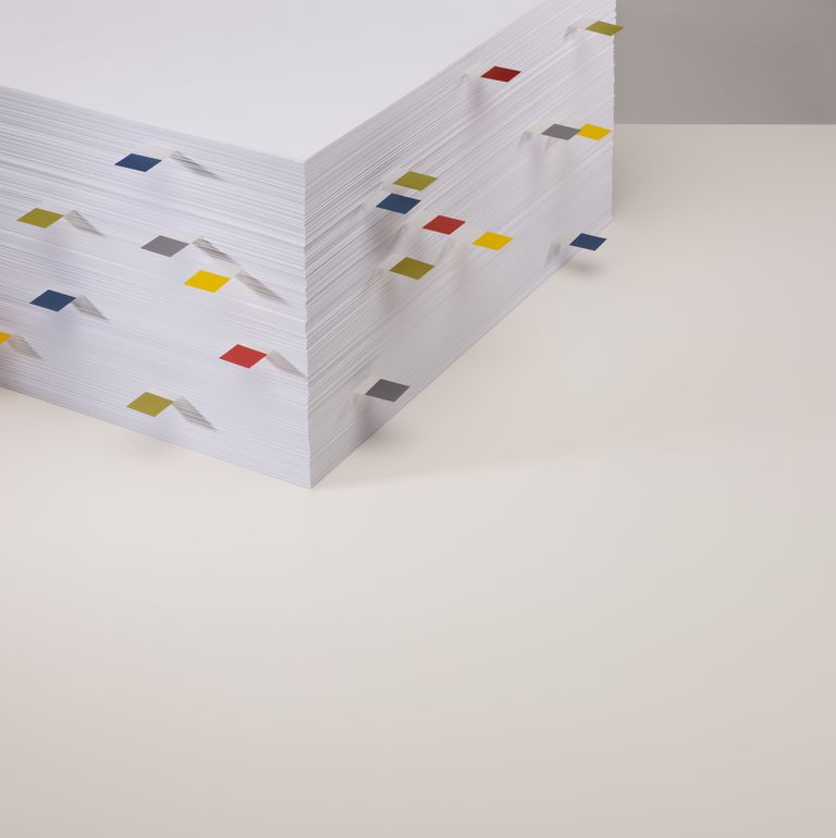 Stack of plain white paper sheets with tabs