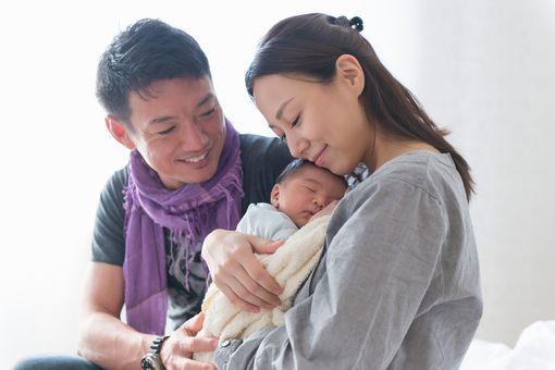 Japanese couple with newborn baby