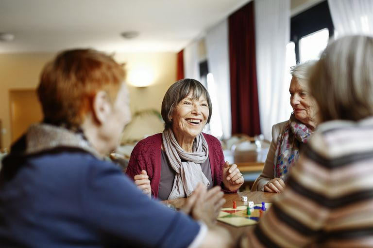 senior women enjoying a board game
