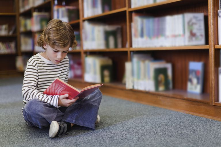 Boy reading in library