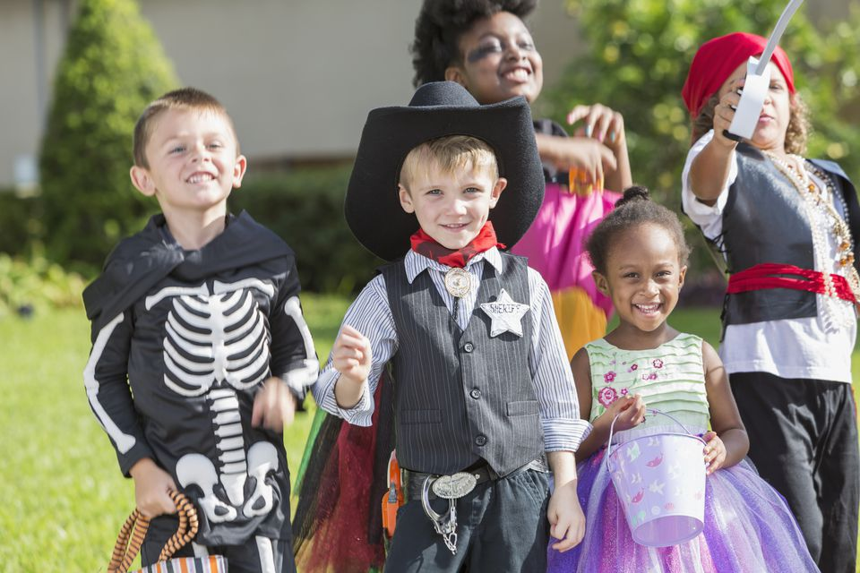 Multi-ethnic group of children in halloween costumes