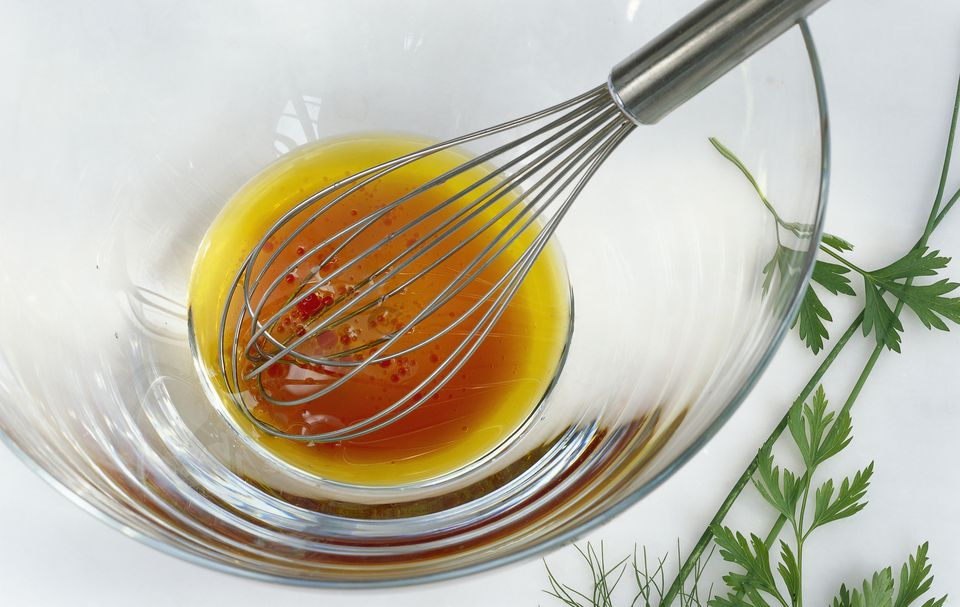 A vinaigrette being whisked