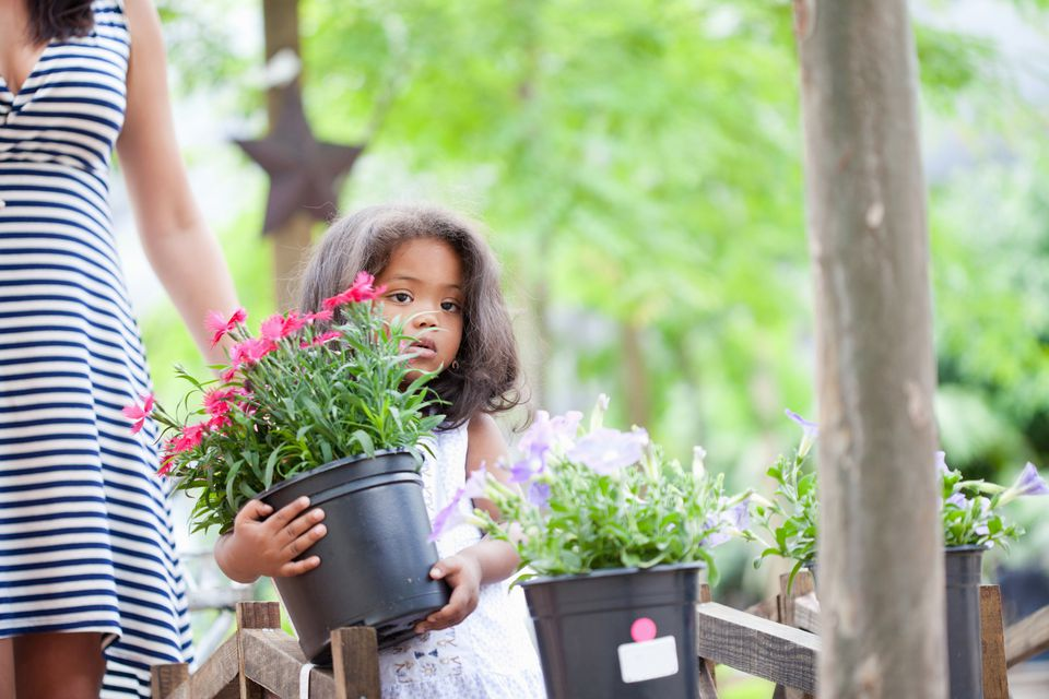 Girl carrying planter outdoors