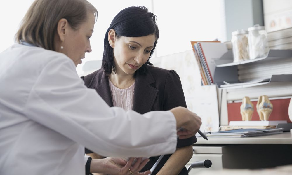 Concerned patient discussing biosimilars with doctor.