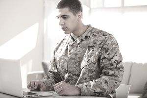 US Marine Corps Solider Working on Laptop