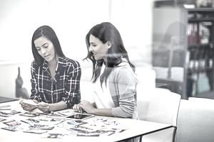 Women reviewing picture in office meeting
