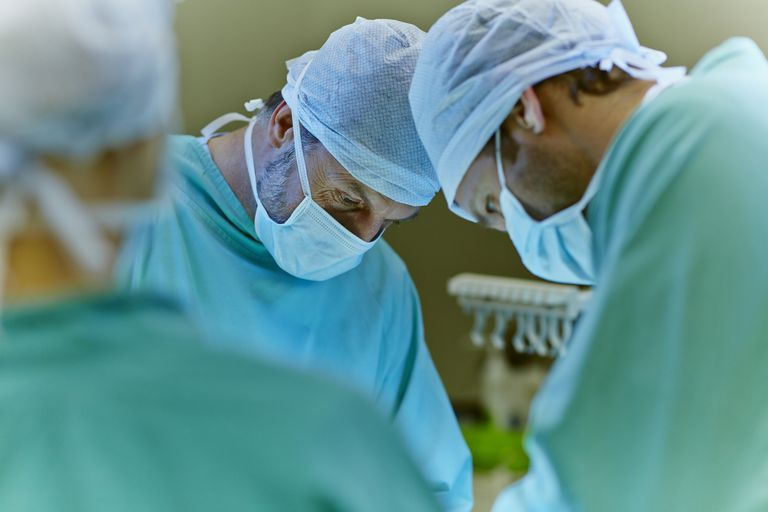 A group of surgeons in the operating room