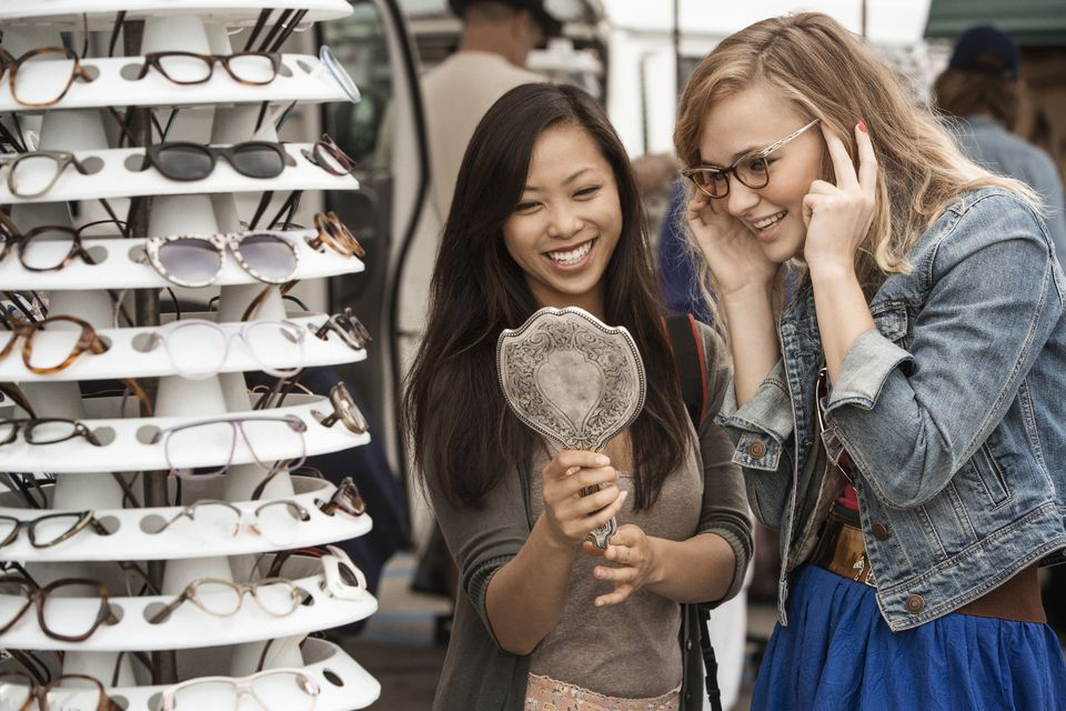 shoppers trying on sunglasses at flea market