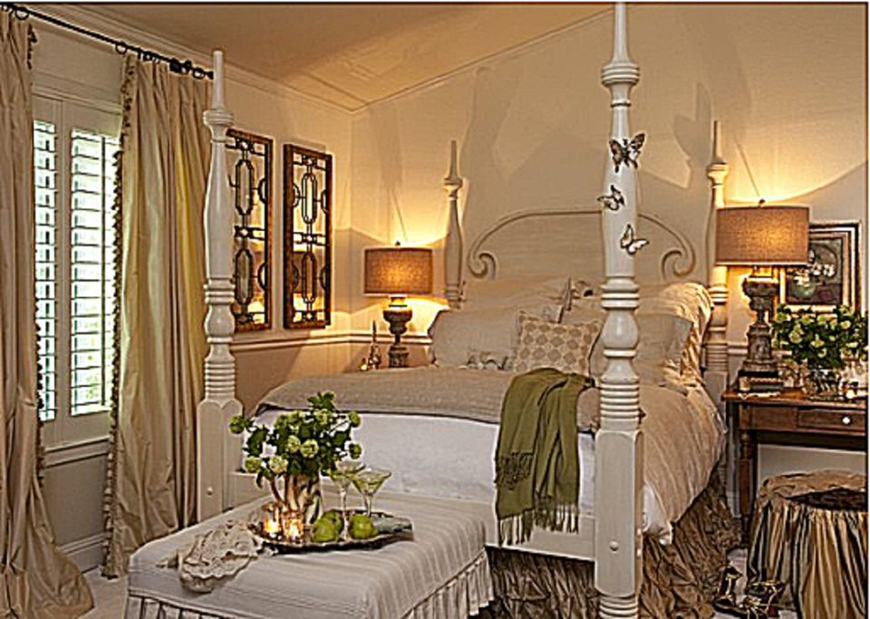 Romantic bedroom with four poster bed. What is the Romantic Decorating Style