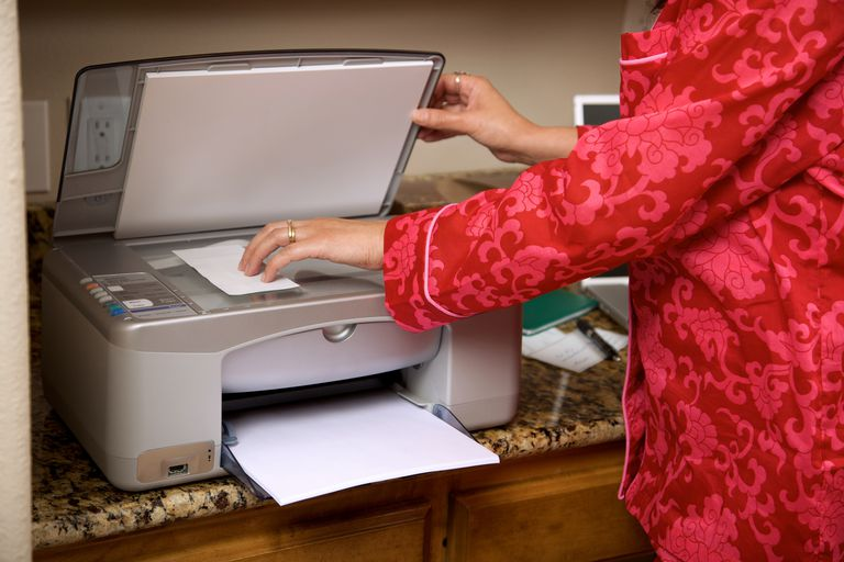 Woman using flat bed scanner