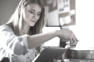 Female design professional using mobile card reader with digital tablet