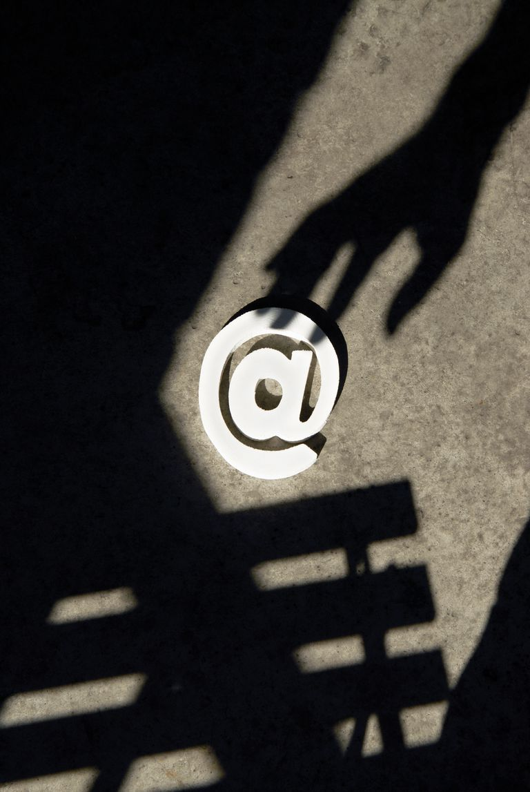 Image of a shadowy hand stealing an at symbol.
