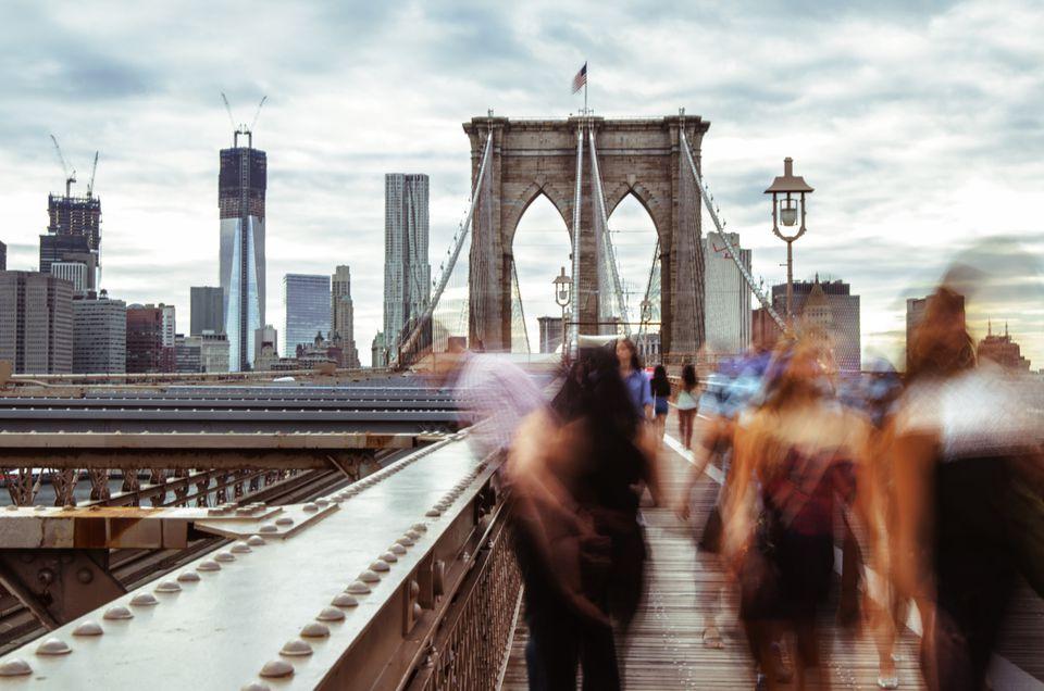People walking across the Brooklyn Bridge