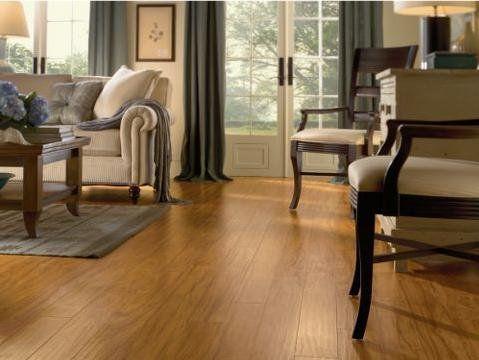 Laminate Flooring In Living Room. Light Golden Afzelia Laminate Living Room Flooring In a Multi Colored Decor